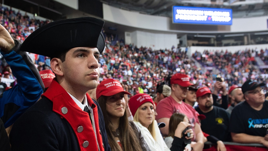 An image of Supporters listening as the US president speaks during a Make America Great Again rally in Green Bay, Wisconsin, April 27, 2019. (Photo by SAUL LOEB / AFP) (Photo credit should read SAUL LOEB/AFP/Getty Images)