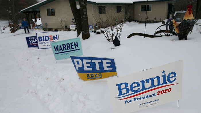 Campaign signs are visible in a front yard in Waverly, Iowa, on Jan. 25, 2020. (Boston Globe via Getty Images)